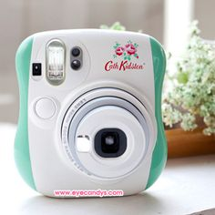 Limited edition camera from collaboration of UK designer Cath Kidston x Fuji Instax Korea! Perfect for spring/summer; Instax fans will not want to miss this! Available in Hot Pink or Mint.  The Fujifilm Instax Mini 25 is a compact, instant film camera that you'll will want to take everywhere. Simple operation makes this point-and-click camera great for birthdays, art projects, or anywhere you'd like to take instant photos. Great fun at parties and gatherings too!
