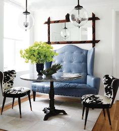 blue leather settee ... LOVE   and those cowhide chairs are AMAZING
