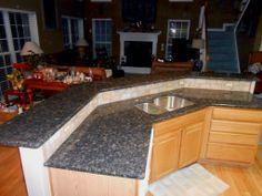 Blue Sapphire Granite Countertop-half inch Bevel edge-3x6 Walnut Travertine tile with Amber Tea Linear Glass accents  11 16 13  www.fireplacecarolina.com