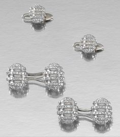 DIAMOND DRESS SET, 1930S.  Comprising: a pair of cufflinks and two dress studs, each oval link embellished with lines of single-cut diamonds, French assay marks.