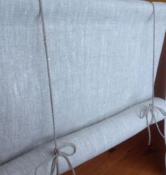 ROLL UP LINEN BLIND  I love the simplicity of this Swedish style, roll up blind  Made from a beautiful heavy weight unbleached linen with natural linen rope for the ties. The colour is like natural oatmeal when against the light.  Hang by putting a rod through the 2 (5cm) rod pocket.  There is a small channel in the bottom hem for a narrow rod to be passed through if preferred. No rods are supplied with the blinds.  Choose from different widths and lengths in the drop down menu or send a…