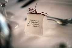 Homemade table decorations, made out of seed imbedded paper - guests can plant them at home for a permanent reminder of the day. C and G's wedding. Caroline Puntis. 'From this day forward, You shall not walk alone.  My heart will be your shelter, And my arms will be your home.' Homemade Tables, Our Wedding, Wedding Ideas, Making Out, Shelter, Arms, Place Card Holders, Plant, Table Decorations