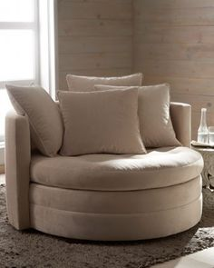 """This is called the """"Cuddle Chair"""". Oh, how I would love to curl up on this with a book!"""