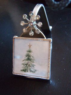 spoon easel with painted charm: could be an easy way to do name cards at the table