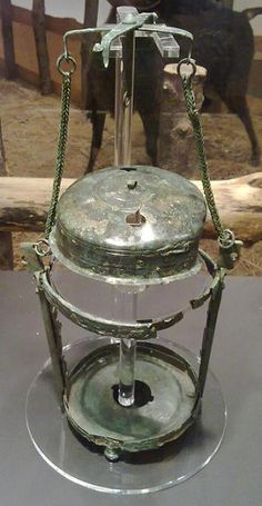 Only intact Roman lamp ever found in UK, after it is restored.  The lamp dates to between the 1st and 3rd centuries A.D. The lantern resembles a modern hurricane lamp and the naked flame would have been protected by a thin sheet of horn — now decomposed — that had been scraped until it was translucent.