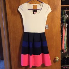 Cute striped skirt dress With tags. Fitted top and bottom skirt flares out a little. Navy, blue and pink striped. Charlotte Russe Dresses Mini