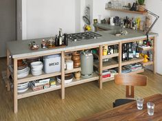 Rainer Spehl is a german designer works hands-on in furniture, interior and exhibition design. This Oak Kitchen Concrete consisting of solid oak framework Kitchen Shelves, Diy Kitchen, Kitchen Interior, Kitchen Dining, Kitchen Decor, Open Shelves, Awesome Kitchen, Kitchen Storage, Open Kitchen Cabinets