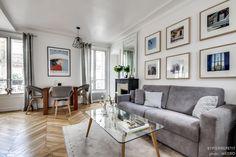 Dans cet appartement moderne, le salon se veut design et d'inspiration scandinave.