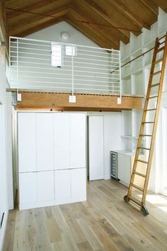 Alluring Garage Loft Apartment in Garage And Shed Modern design ideas with Alluring built-in shelves exposed beams library ladder light wood floor rolling ladder vaulted