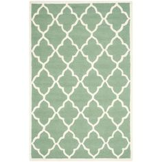 Soften your bedroom or living room scheme with this hand-tufted rug, showcasing a trellis motif in teal and ivory tones.     P...