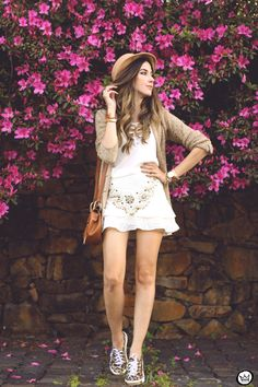 White outfit wearing a cute beaded skirt and gorgeous top from MondaBelle. Accessories in camel with leopard sneakers.