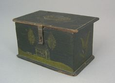 "Jacob Weber(1772-1865), Fivepointville, Lancaster County, Pennsylvania, dated 1850, painted pine dresser box, the lid and sides with tulips on a dark green ground, the front with a brick house, trees, and lawn with fence, 3"" h., 5 1/4"" w."