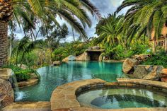 Love the plaster color for this lagoon style pool