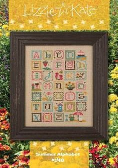 "Lizzie Kate's cross stitch pattern titled ""ABC Summer Sampler"" that includes a charm."