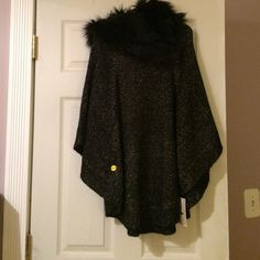 Michael kors poncho Brand new with tags Michael kors poncho with detachable fake fur neck piece. Black with gold shimmer in the poncho. Michael Kors Sweaters Shrugs & Ponchos