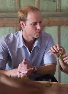 Prince William, Duke of Cambridge tries some sticky rice wrapped in banana leaves as he visits Mengman village on March 4, 2015 in Xishuangbanna, China. Prince William, Duke of Cambridge is on a four day visit to China. He is the most senior royal to visit China since the Queen and Duke of Edinburgh in 1986. His visit follows on from a successful four day visit to Japan.
