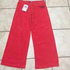 NEW JUICY COUTURE terry capris pants sz S red nice NEW JUICY COUTURE terry pants capris red color sz S 100 % Authentic long 31 in inseam 25 in rise 7 in waist 14 in Juicy Couture Pants Capris