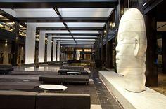 Renovated lobby at Grand Hyatt New York featuring artwork by Jaume Plensa