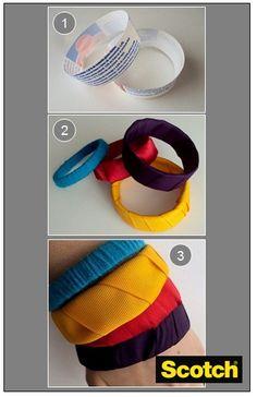 ¡Tus accesorios favoritos !   Materiales : Recipiente de plástico, Tijeras Scotch Multiusos, Pegamento Scotch Super Glue, Tela o cinta de tu preferencia.   Paso 1: Recortar el recipiente de plástico con las Tijeras Scotch Multiusos por el medio o según sea el tamaño de tu brazo.  Paso 2: Pegar la tela o cinta de tu preferencia con Pegamento Super Glue en forma circular al rededor del recipiente de plástico.  Paso 3: Ordena las pulseras como tu quieras según los colores y tamaños.