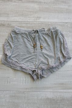 Start your festive dreams wearing these adorable lace and pom pom boho shorts. They feature an elastic waistband and drawstring as well as double layered material. The material above is soft acid wash