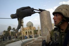 Marine Kirk Dalrymple watches as a statue of Iraq's President Saddam Hussein falls in central Baghdad. troops pulled down the high statue as Iraqis danced on it in contempt for the man who ruled them with an iron grip for 24 years. Bagdad, The Americans, Barack Obama, Statue, Saddam Hussein, Powerful Pictures, Tony Blair, Iraq War, Baghdad Iraq
