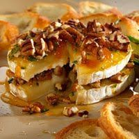 I make this yummy appetizer when I have people over A LOT. It is SO quick and easy and people FREAK on it! It is a Pampered Chef recipe that...