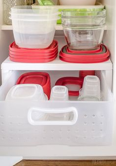 Use a plastic drawer organizer to separate big containers from small ones.