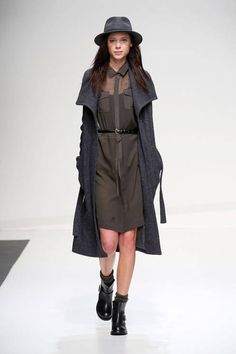 Stefanel F/W 2014 low structured shiny leather boots, bare legs, dark trench, fedora , neutral-monotoned.