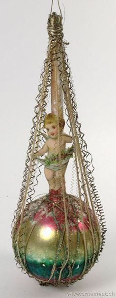 Ornament: Victorian - These old ornaments are somewhat crudely put together, but always gorgeous. This little scrap Cupid is perfect!