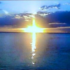 A cross of light over the ocean. When you feel like you're drowning in the world's troubles, Jesus is the light that saves.