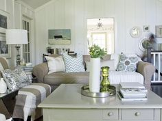 The color scheme for this cottage living room is creamy whites, tans, sea greens, soft blues and a pop of chartreuse.