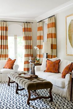 Horizontal striped curtains, but in navy and white.  I like this rug too.