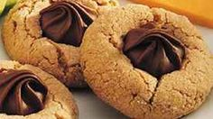 These peanut butter cookies are special for the holidays or anytime.  Their secret is the chocolate candy that melts into the top.