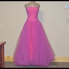 """Quinceanera, Ball Gown, Prom Dress Sequins, tulle skirt and corset. Strapless. Bought sz 10, took in the stays inside the corset (pictured) fits size 4 now. She took out some of the under skirt. Dress fits 4-10. I am 5'2"""" in photo with flip flops. Mannequin is 6  foot. some snags & wear on bottom of skirt (pictured) but there's too much tulle to see it. I would dry clean but our cleaners ruin things. Comes with pink satin hanger. Mori Lee Dresses Prom"""