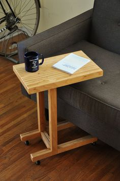 The handy geometry of the C Table allows the surface to extend over your sofa or seat, making it easy to keep drinks, books, or a laptop within comfortable reach. It can be fitted with casters (shown) as an option for even easier movement. DIMENSIONS: 18W x 11D x 24H INCLUDES: + FSC certified birch plywood + All natural, biodegradable, and non-toxic finishes--easy damp cloth clean-up! FREE local delivery or pick-up within Los Angeles! Please message me for options.