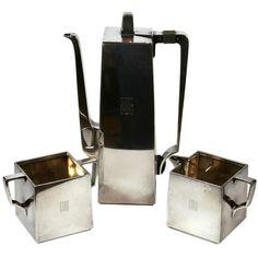 Art Deco Tea Set, Tiffany (Bauhaus-influenced design), United States, sterling silver, 1930's.  https://www.1stdibs.com/furniture/dining-entertaining/tea-sets/rare-tiffany-bauhaus-influence-art-deco-tea-set/id-f_372719/?devicetype=desktop