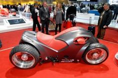 Pendolauto Leaning Motorcycle  This unusual motorcycle leans into turns like a motorcycle would, yet features four wheels, like a car.