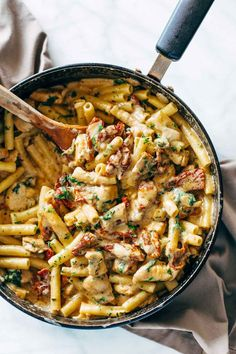 Sun Dried Tomato Chicken Florentine Pasta - a 30 minute recipe with a sun dried tomato cream sauce, chicken, ziti, and Mozzarella cheese.