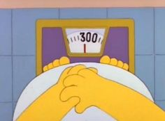 Homer Simpson standing on scales
