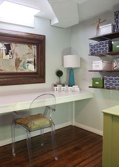 Love her style. This is a basement craft room.