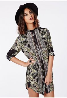We are mega lusting over this chic collarless shirt dress this season. The luscious long sleeves, hidden button down fasten, pocket at the breast and pretty paisley print design make this dress a must-have. Team with ankle boots and fedora ...