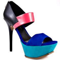 You'll be feeling radiant and ravishing in these color blocked heels from Jessica Simpson. Vadio is multi colored pump with a 5 inch black patent heel. This bright pump has a 1 1/2 inch teal suede platform and a pink suede strap at the vamp. Make your next entrance a memorable one in these stunning stilettos!