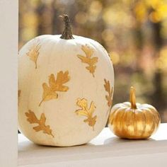 "Literally ""gold leaf"" your pumpkins by spray painting leaves with metallic gold and adhering them to a painted pumpkin!"