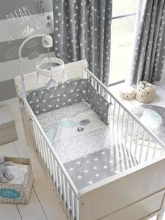 Opting for white and grey shades in the baby's nursery is great if you're unsure of the sex. Shop this look by tapping the image!