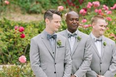 stylish groom + groomsmen watching the bride make her entrance. Love those mismatched print bow ties - polka dots, plaid + stripes!