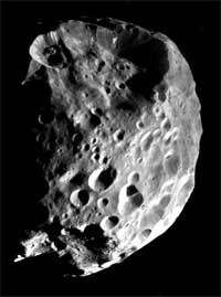 Saturn's moon Phoebe. Phoebe (FEE-bee) is one of Saturn's most intriguing satellites, orbiting at a distance of 12,952,000 kilometers from the planet, almost four times the distance from Saturn than its nearest neighbor, the moon Iapetus. Phoebe and Iapetus are the only major moons in the Saturnian system that do not orbit closely to the plane of Saturn's equator.  Phoebe has a diameter of about 220 kilometers. It's orbit is retrograde, i.e. it orbits Saturn opposite to Saturn's rotation.