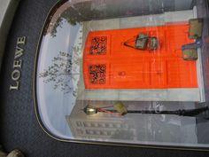 Neon orange door -Loewe shop - Barcelona
