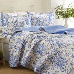 Artfully quilted with a delicate floral motif, this charming reversible quilt set makes the perfect addition to your master suite.