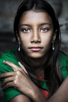 David Lazar Girl With Green Eyes Taken in Bangladesh, this portrait features a young lady's green eyes.
