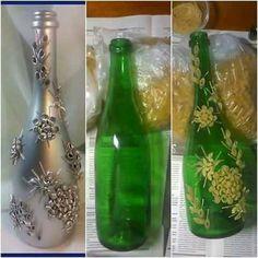 Botella decorada con silicona caliente y luego pintada